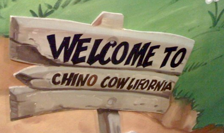 """a picture of a welcome sign that states, """"Welcome To Chino Cowlifornia"""""""